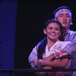 Qiao (Nicole Barredo) and Xian (Daniel May) look out across the Square in awe of how the student movement has grown in East West Players' Spring Musical Beijing Spring, playing through June 15th.